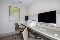 Business Center with  Wall Mounted iMacs and Free Printing