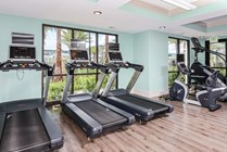 24 Hour Fitness Center with Cardio Equipment and Full Size Stair Master
