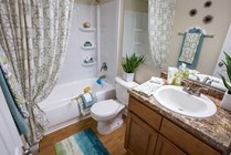 Newly remodeled bathrooms featuring large mirrors.