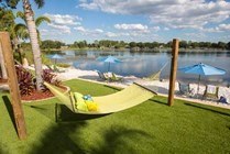 Hammock garden located next to our lakeside beach area.